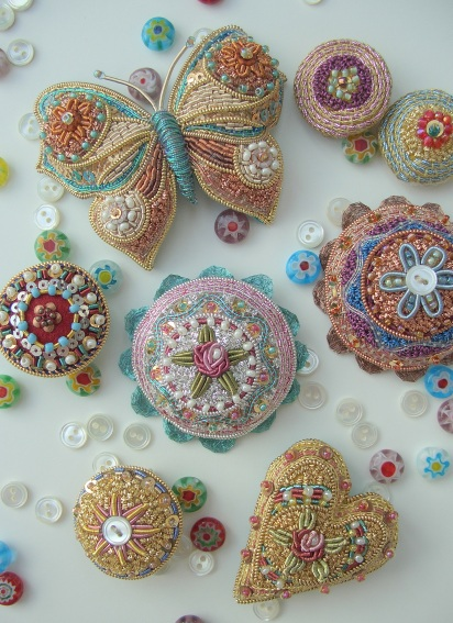 A Selection of Millefiori Brooches, including hearts, round brooches and butterfly brooches - Copy